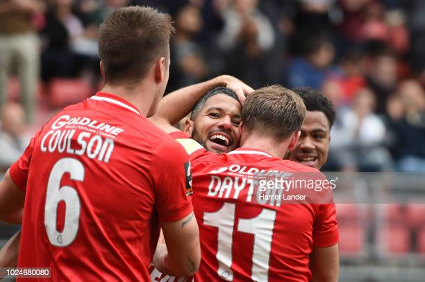 Jobi McAnuff of Leyton Orient celebrates with teammates after scoring his team's first goal during the Vanarama National League match between Leyton...