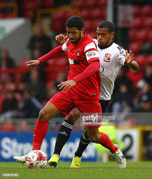 Jobi McAnuff of Leyton Orient looks to get away from Swindon's Louis Thompson during the Sky Bet League One match between Leyton Orient and Swindon...