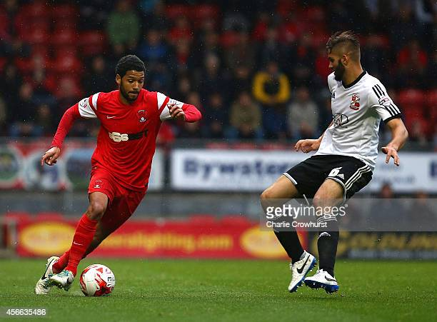 Jobi McAnuff of Leyton Orient looks to get past Jordan Turnball of Swindon during the Sky Bet League One match between Leyton Orient and Swindon Town...