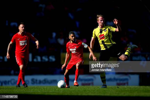 Jobi McAnuff of Leyton Orient tackles with Mark Beck of Harrogate Town during the Vanarama National League match between Leyton Orient and Harrogate...
