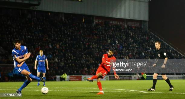 Jobi McAnuff of Leyton Orient takes a shot at goal which was bloacked by Liam Nolan of Salford during the Vanarama National League match between...