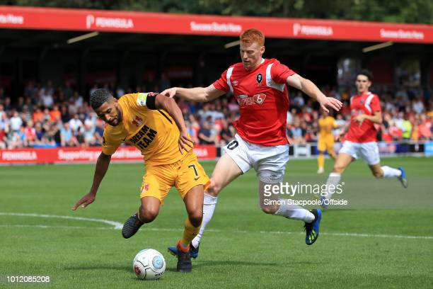 Jobi McAnuff of Orient battles with Rory Gaffney of Salford during the Vanarama National League match between Salford City and Leyton Orient at Moor...