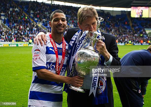 Jobi McAnuff of Reading and Reading Chairman Sir John Madejski celebrate with the npower Championship Trophy during the Reading Football Club...