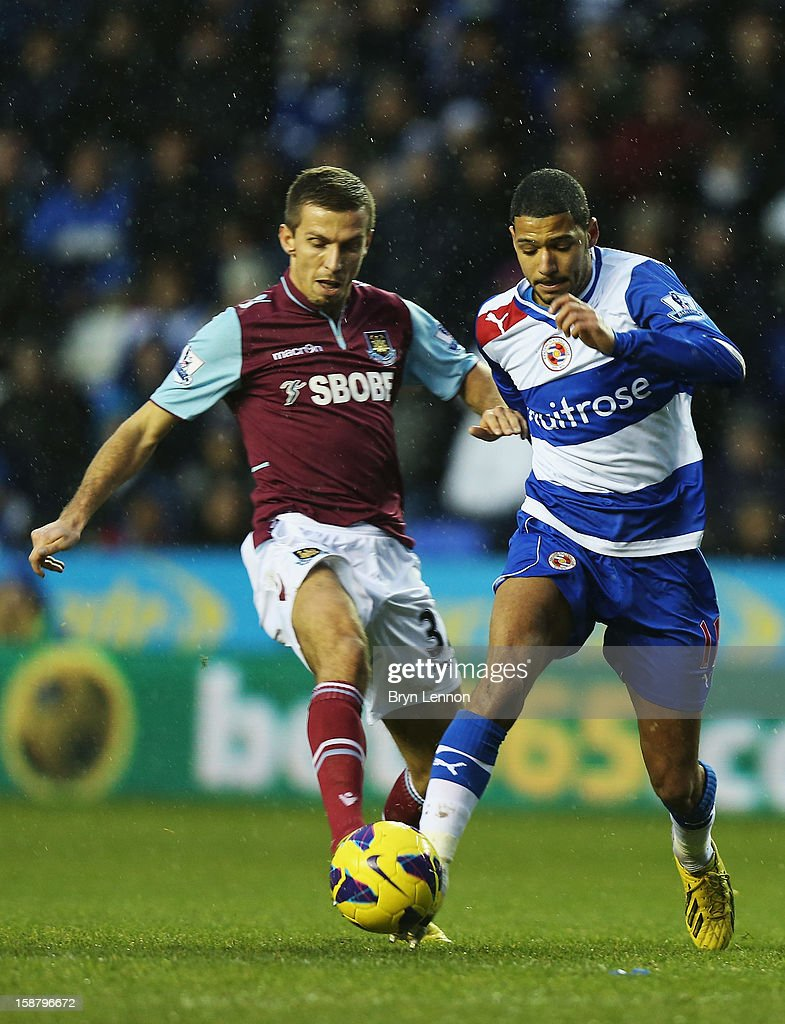 Jobi Mcanuff of Reading battles with Gary O'Neil of West Ham United during the Barclays Premier League match between Reading and West Ham United at the Madejski Stadium on December 29, 2012 in Reading, England.