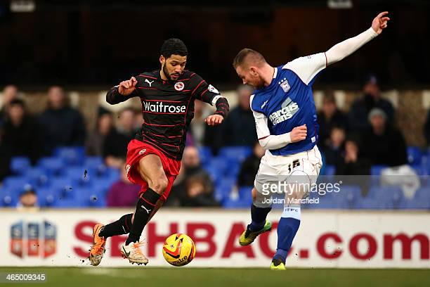Jobi McAnuff of Reading FC battles for the ball with Ryan Tunnicliffe of Ipswich during the Sky Bet Championship match between Ipswich Town and...
