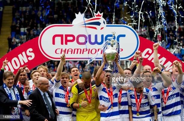 Jobi McAnuff of Reading lifts the npower Championship trophy during the Reading Football Club Championship Trophy Victory Parade at Madejski Stadium...