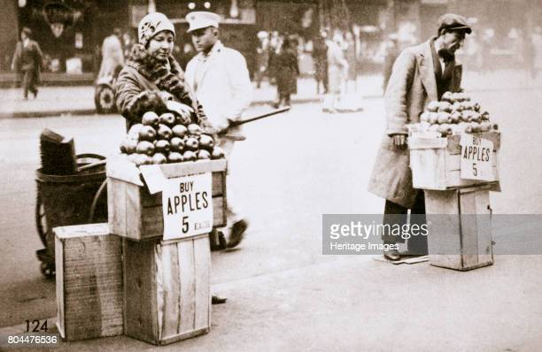 Jobless New Yorkers selling apples on the pavement Great Depression New York USA 1930