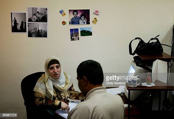 Jobs Consultant Adhyaf Abdalhalim Counsels A Job Applicant In Her Cubicle On June 21 2004 At