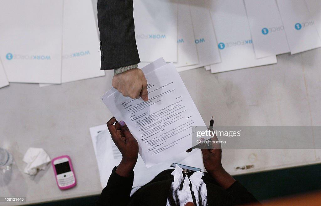 A job-seeker (top) hands his resume to Candice Perkins, a representatvie of Workforce1, an city-sponsored employment agency, during a 'Work Search' event aimed at older unemployed people January 18, 2011 at a high school gymnasium in the Harlem neighborhood of New York City. The event, sponsored by the American Association of Retired Persons (AARP), consisted of workshops for basic job skills like resume building targeted to an over-50 job seeking demographic. Unemployment for older worker has decreased slightly in the past year, though rates are still three times higher than they were a decade ago, when only 2.5 percent of people over 45 were jobless.