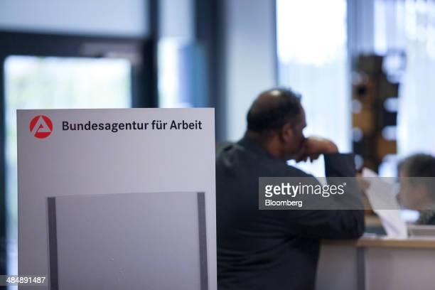 A jobseeker stands in the reception area inside a Agentur fuer Arbeit employment office in Stuttgart Germany on Monday April 14 2014 German...