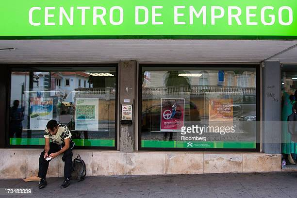 A jobseeker waits outside an employment center in Sintra Portugal on Monday July 15 2013 President Anibal Cavaco Silva said that early elections...