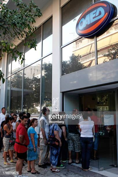 Jobseekers enter a Labor Force Employment Organisation job center soon after opening in Athens Greece on Tuesday Aug 20 2013 Greece's final exit from...
