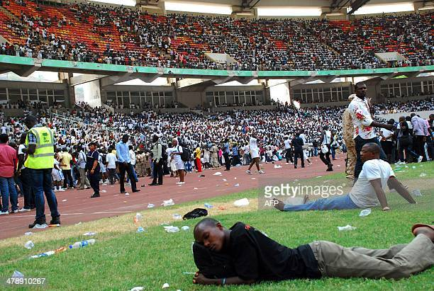 Jobseekers lie on the pitch after a stampede in Abuja National Stadium where thousands of jobseekers came to apply for work at the Nigerian...