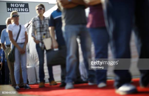 Jobseekers line up to enter an Amazoncom job fair in Kenosha Wisconsin US on Wednesday Aug 2 2017 The US Department of Labor is scheduled to release...