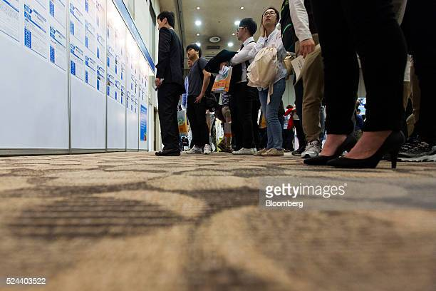 Jobseekers look at listings displayed at a job fair in Goyang South Korea on Tuesday April 26 2016 South Korea's economy slowed in the first quarter...