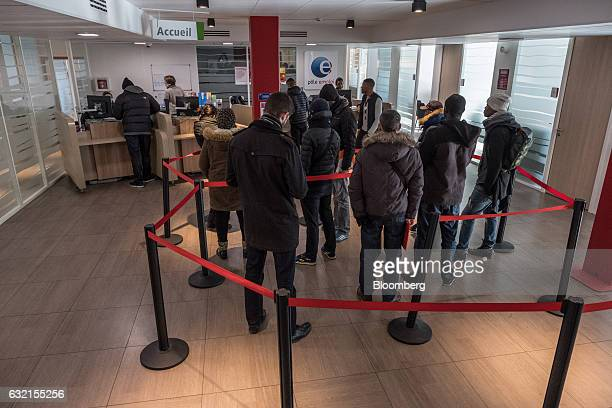 Jobseekers queue at service counters inside a Pole Emploi national employment agency in Toulouse France on Thursday Jan 19 2017 Joblessness will be...