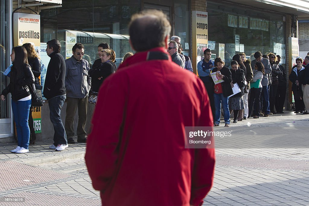 Jobseekers queue outside an employment office before opening in Madrid, Spain, on Thursday, April 25, 2013. Spanish unemployment rose more than economists forecast in the first quarter to the highest in at least 37 years as efforts to tackle the European Union's biggest budget deficit crimped economic growth. Photographer: Angel Navarrete/Bloomberg via Getty Images