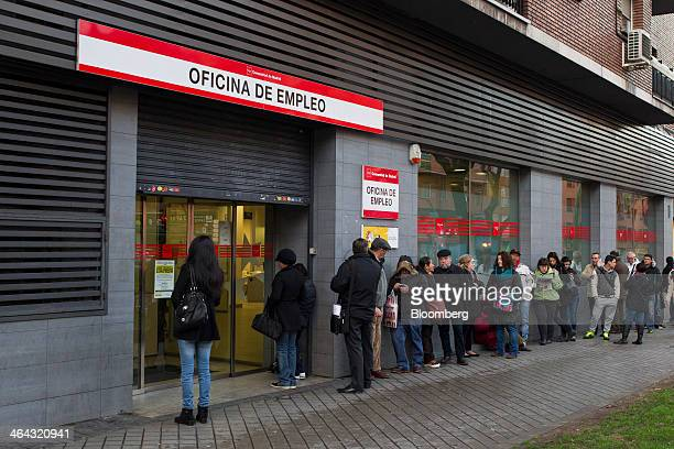 Jobseekers queue to enter an employment center before opening in Madrid Spain on Wednesday Jan 22 2014 The worst of Europe's debt crisis is over in...