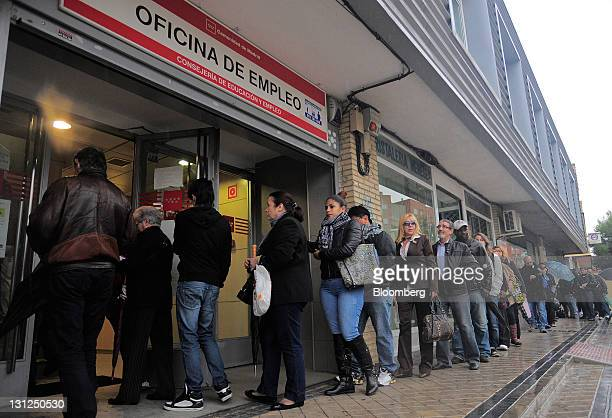 Jobseekers queue to enter an employment office shortly after it opened in Madrid Spain on Thursday Nov 3 2011 Registered unemployment in Spain where...