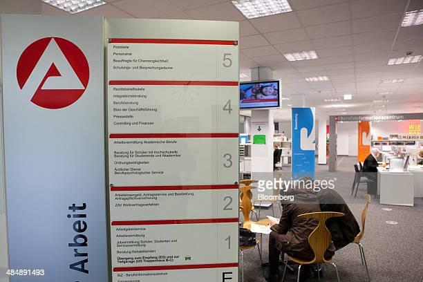Jobseekers read documents inside a Agentur fuer Arbeit employment office in Stuttgart Germany on Monday April 14 2014 German unemployment fell for a...