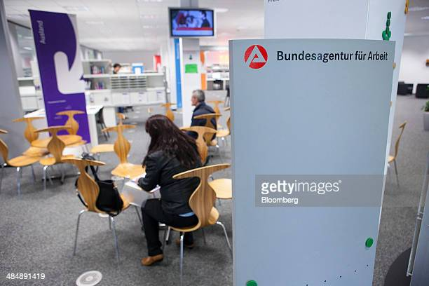 Jobseekers sit inside a Agentur fuer Arbeit employment office in Stuttgart Germany on Monday April 14 2014 German unemployment fell for a fourth...