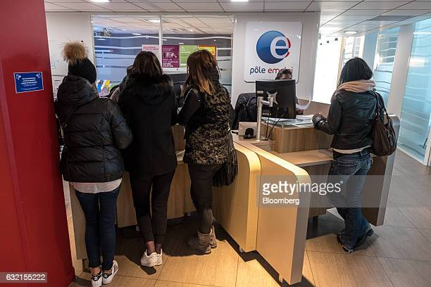 Jobseekers stand at service counters inside a Pole Emploi national employment agency in Toulouse France on Thursday Jan 19 2017 Joblessness will be...