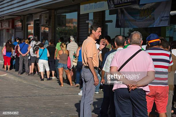 Jobseekers stand in a queue outside an employment center in Madrid Spain on Wednesday July 23 2014 While unemployment figures tomorrow will show that...