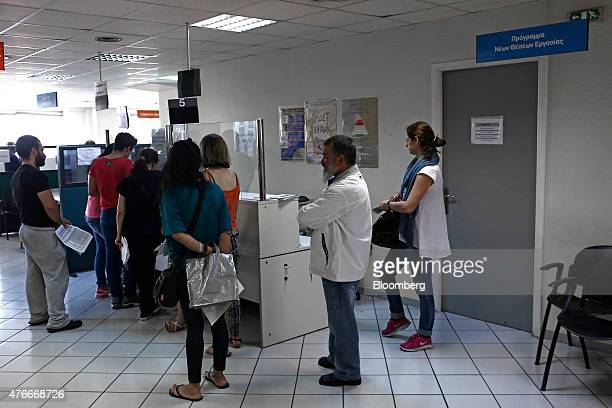 Jobseekers wait at a service desk inside a job center shortly after opening in Athens Greece on Thursday June 11 2015 European Union President Donald...