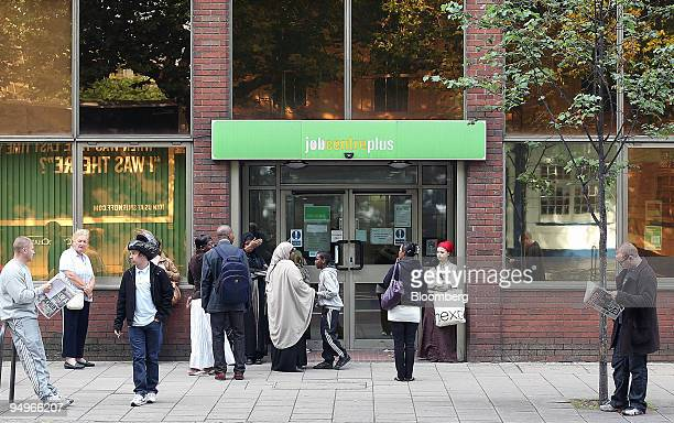Jobseekers wait outside a Job Centre in London UK on Thursday July 30 2009 UK consumer confidence rose to the highest level in more than a year last...