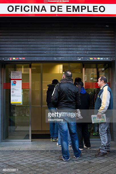 Jobseekers wait to enter an employment center shortly after opening in Madrid Spain on Wednesday Jan 22 2014 The worst of Europe's debt crisis is...