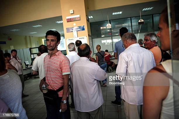 Jobseekers wait to see advisors inside a Labor Force Employment Organisation job center in Athens Greece on Tuesday Aug 20 2013 Greece's final exit...