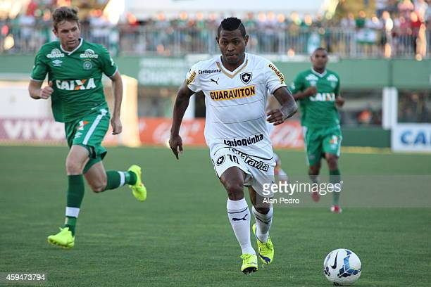 Jobson of Botafogo struggles for the ball with a Fabiano of Chapecoense during a match between Chapecoense and Botafogo for the Brazilian Series A...