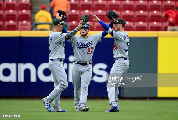 Joc Pederson Alex Verdugo and Cody Bellinger of the Los Angeles Dodgers celebrate after the final out of the 83 win against the Cincinnati Reds at...
