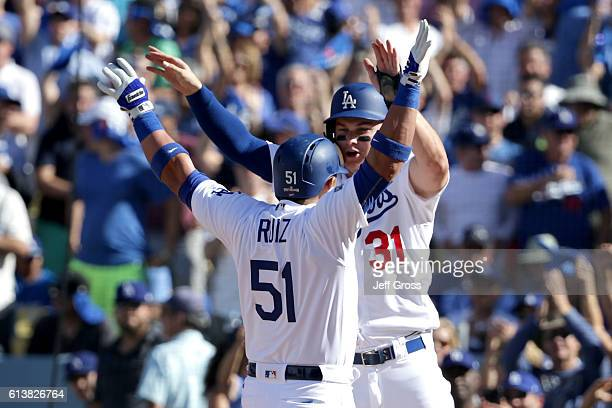 Joc Pederson celebrates with Carlos Ruiz of the Los Angeles Dodgers after Ruiz hits a tworun fifth inning home run against the Washington Nationals...