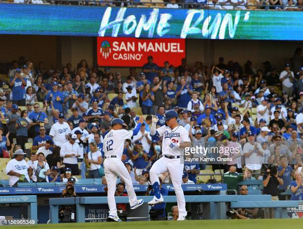 Joc Pederson is congratulated by third base coach Dino Ebel of the Los Angeles Dodgers as he rounds the bases after hitting a solo home run in the...