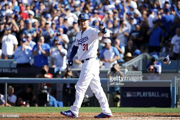 Joc Pederson is walked scoring Justin Turner of the Los Angeles Dodgers with the bases loaded in the third inning during game four of the National...