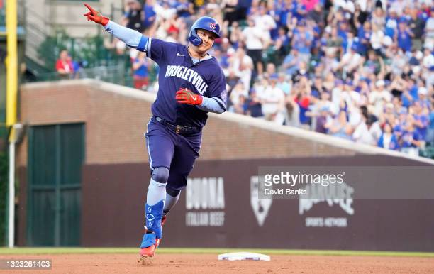 Joc Pederson of the Chicago Cubs runs the bases after hitting a home run against the St. Louis Cardinals during the fourth inning at Wrigley Field on...