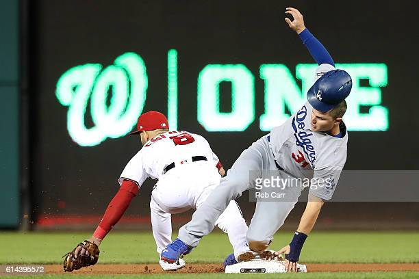 Joc Pederson of the Los Angeles Dodgers advances to second base against Danny Espinosa of the Washington Nationals in the fifth inning during game...