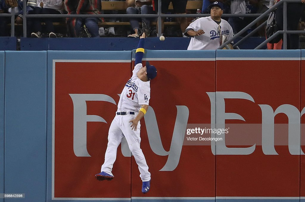 Joc Pederson #31 of the Los Angeles Dodgers can't make the catch as the ball goes over the center field wall for a homerun during the eighth inning of their MLB game against the San Diego Padres at Dodger Stadium on September 2, 2016 in Los Angeles, California.