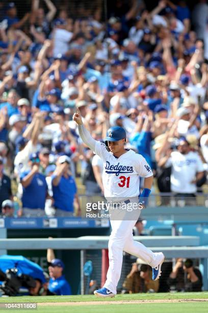 Joc Pederson of the Los Angeles Dodgers celebrates a home run during the fifth inning against the Colorado Rockies at Dodger Stadium on Monday...