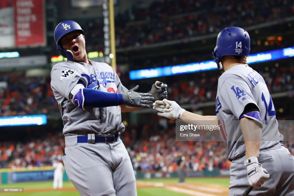 Joc Pederson #31 of the Los Angeles Dodgers celebrates after hitting a three-run home run during the ninth inning against the Houston Astros in game four of the 2017 World Series at Minute Maid Park on October 28, 2017 in Houston, Texas.