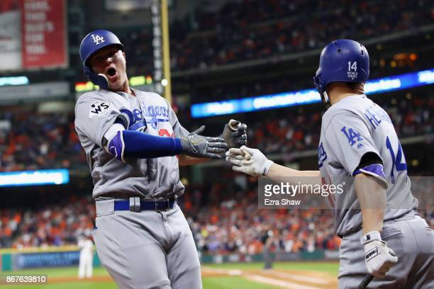 Joc Pederson of the Los Angeles Dodgers celebrates after hitting a threerun home run during the ninth inning against the Houston Astros in game four...