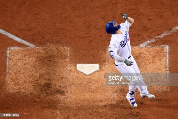 Joc Pederson of the Los Angeles Dodgers celebrates after hitting a solo home run during the seventh inning against the Houston Astros in game six of...