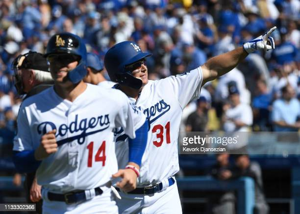 Joc Pederson of the Los Angeles Dodgers celebrates after hitting his second two run home run during the sixth inning against Arizona Diamondbacks at...