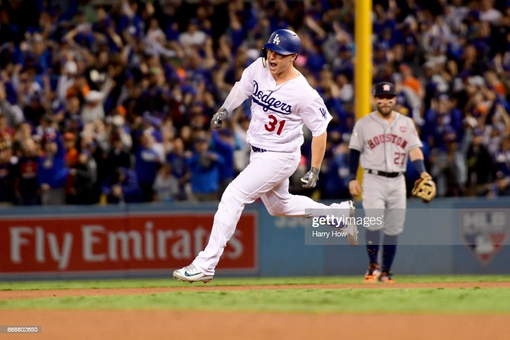 Joc Pederson #31 of the Los Angeles Dodgers celebrates as he runs the bases after hitting a solo home run during the seventh inning against the Houston Astros in game six of the 2017 World Series at Dodger Stadium on October 31, 2017 in Los Angeles, California.
