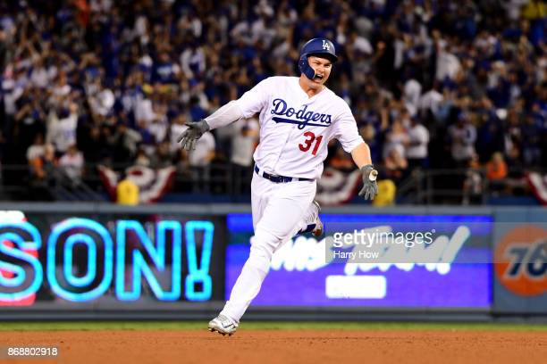 Joc Pederson of the Los Angeles Dodgers celebrates as he runs the bases after hitting a solo home run during the seventh inning against the Houston...