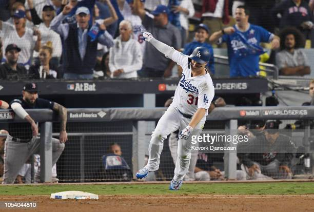 Joc Pederson of the Los Angeles Dodgers celebrates his third inning home run against the Boston Red Sox in Game Three of the 2018 World Series at...