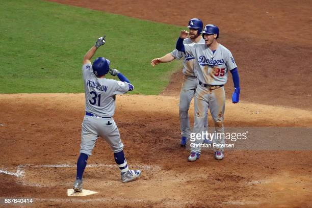 Joc Pederson of the Los Angeles Dodgers celebrates hitting a threerun home run during the ninth inning against the Houston Astros in game four of the...