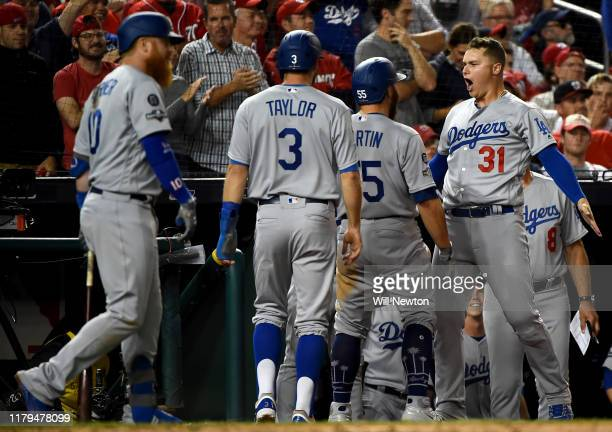 Joc Pederson of the Los Angeles Dodgers celebrates with Russell Martin and Chris Taylor after they scored on a two run RBI double by teammate Kike...