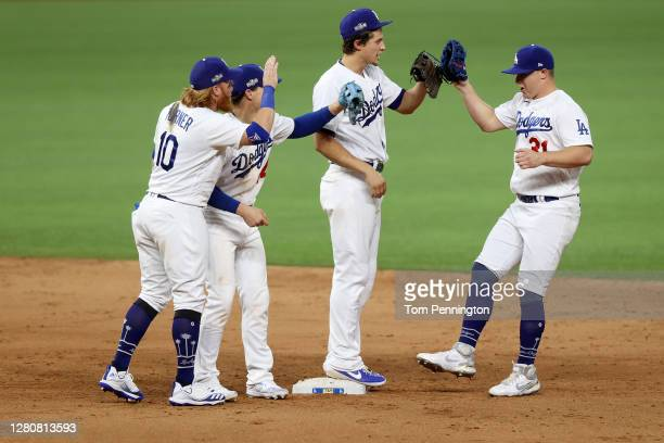 Joc Pederson of the Los Angeles Dodgers celebrates with teammates following their 3-1 victory against the Atlanta Braves in Game Six of the National...